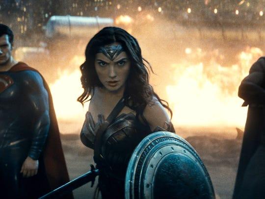 Henry Cavill as Superman, left, Gal Gadot as Wonder