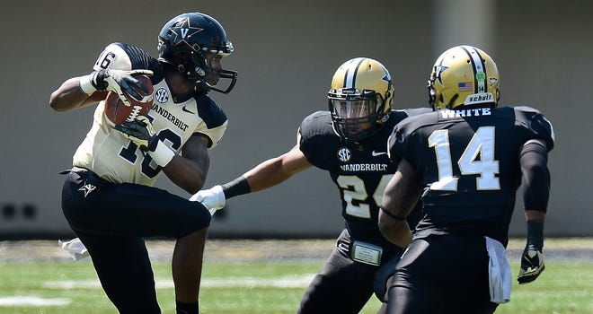 Vanderbilt wide receiver Gerald Perry (16) catches a pass in front of safety Jalen Banks (24) and safety Ryan White (14) during the Vanderbilt spring football game on April 12.