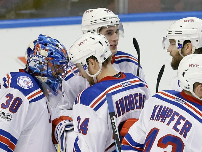New York Rangers goalie Henrik Lundqvist (30) is congratulated