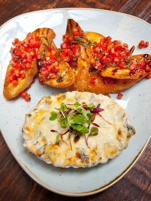 Le Moo Restaurant Chef Hayley Charron's spinach artichoke dip with garlic toast points and fresh brochette is a featured dish of the eatery.