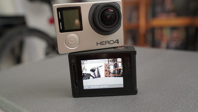 GoPro's new Hero4 Black edition, top, sells for $499, while the Hero4 Silver ($399) differs by having an LCD viewfinder.
