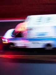 A file photo showing an ambulance speeding along a street. The Washoe County Regional Medical Examiner's Office announced the identity of a man who was hit and killed by a vehicle on April 6, 2019, on Interstate 580.