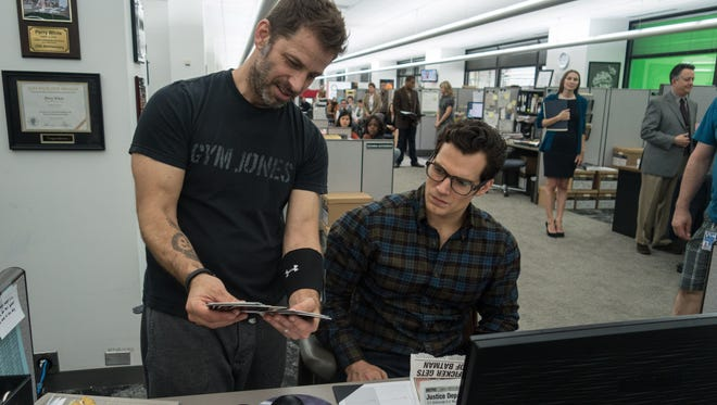 """Zack Snyder (left, with Henry Cavill on the set of """"Batman v Superman"""") is busy filming """"Justice League"""" in England."""