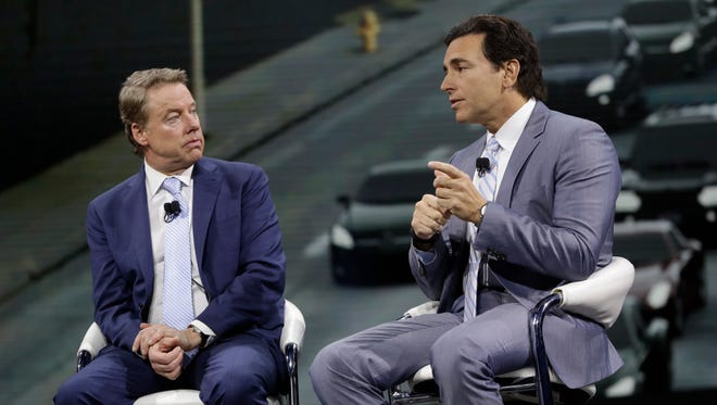 Ford Motor Co. Executive Chairman Bill Ford, left, listens as President and Chief Executive Mark Fields speak at the North American International Auto show. In a joint statement shared with employees Monday, Ford and Fields said the company does not support Trump's executive order issued Friday, which banned those from seven Middle Eastern countries from entering the U.S. for the next 90 days.