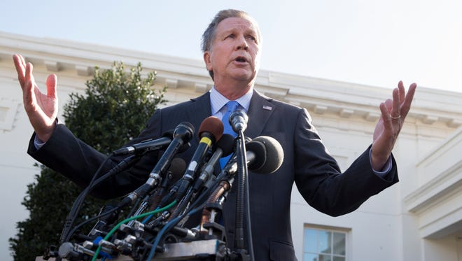 Ohio Gov. John Kasich responds to questions from members of the media outside the White House following his meeting with President Trump on Feb. 24, 2017.