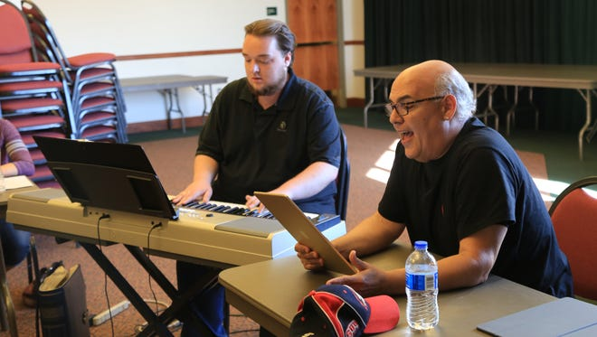 "Brandon Grayson and Peter Sham rehearse songs from Sham's new musical ""Under Construction: The Blue Collar Musical"" on Monday at the Heritage Cetner in Cedar City."