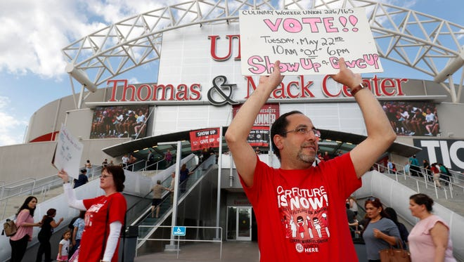 Union organizers hold signs as members of the Culinary Workers Union, Local 226, file into a university arena in Las Vegas where they voted to authorize a strike in the city's casinos. The vote will not immediately affect the casinos, but it would give union negotiators a huge bargaining chip by allowing them to call for a strike at any time starting June 1.