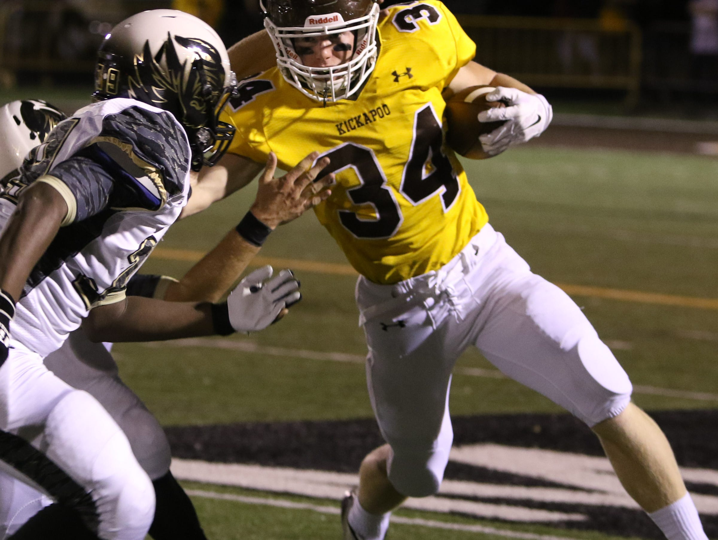 Kickapoo High School running back Maverick McGee fights off Lee's Summit's defense Friday, October 23, 2015. Jason Connel / For the News-Leader