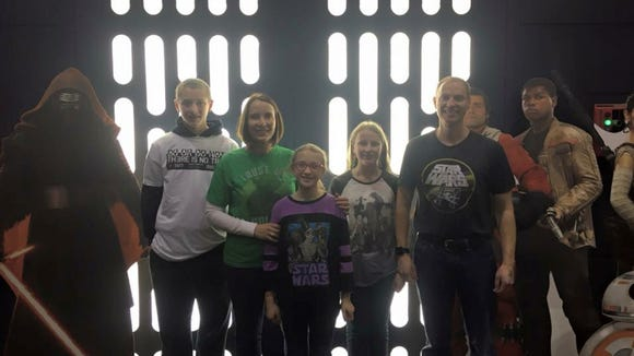 Sioux Falls resident Corinne Lee, poses with her family