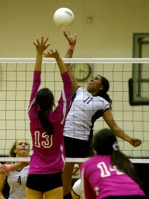 Piedra Vista's Autumn Begay tips the ball over the net on Thursday during a match against Aztec at Lillywhite Gym.