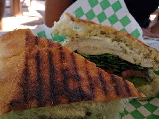 Cravings' grilled Tuscacado is grilled ciabatta sandwich