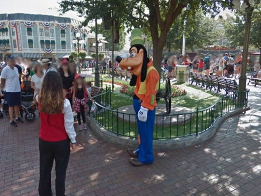 Run into Goofy along Main Street U.S.A. via Google