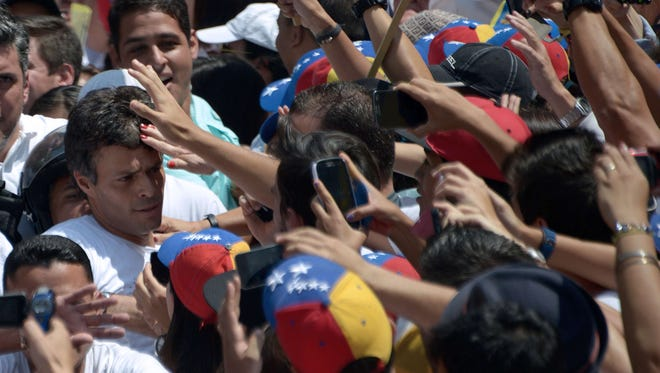 Leopoldo Lopez, an ardent opponent of Venezuela's socialist government, awaits charges in court Wednesday after President Nicolas Maduro ordered his arrest on charges of homicide and inciting violence during anti-government protests.