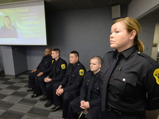 The Green Bay Police Department swore in five new officers April 6, 2015. Ptl. Jamie Wozniak, right, is introduced during the ceremony.
