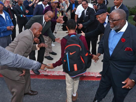 """About 70 men from the community greeted students arriving at Tindley Preparatory Academy on Oct. 5, 2015. """"We got men who came from all walks of life,"""" said the Rev. Preston T. Adams. """"Barbers, lawn care professionals, law enforcement, clergy, attorneys, the mayor ... they would all come and participate."""""""