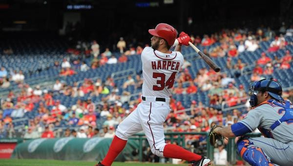 Washington's Bryce Harper hits a game-winning two-run home run to beat the Mets 5-3 in the 13th inning at Nationals Park Thursday.