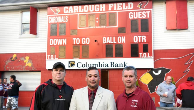 The Pompton Lakes Riverdale Youth Organization celebrated the donation of a $15,000 scoreboard at Carlough Field in Pompton Lakes from the local Columbia Savings Bank. From left: PLRYO Vice President Dennis McNamara, bank Branch Manager Gene Hoffman, and the organization's president, Rob Sturla.