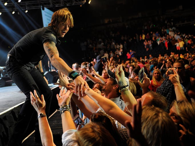 Keith Urban thanks fans for coming to the annual All 4 the Hall benefit concert at Bridgestone Arena on Tuesday, May 6, 2014, in Nashville, Tenn.