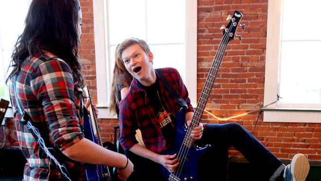 Jake Rybloom, 14, of Salem, practices a performance move for Stella Lawson, 16, of Albany, during a rehearsal for the River City Rock Star Academy at the Reed Opera House in Salem.