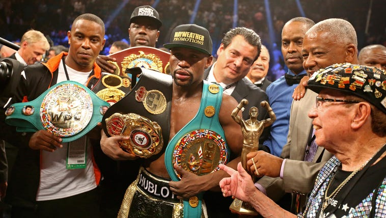 Floyd Mayweather Jr celebrates with the championship