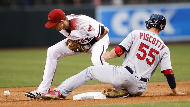 St. Louis Cardinals' Stephen Piscotty slides into second safe after Arizona Diamondbacks' Nick Ahmed bobbles the ball on the play as the Arizona Diamondbacks face off against the St. Louis Cardinals on Wednesday, April 27, 2016, at Chase Field in Phoenix, Ariz.