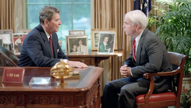 President Ronald Reagan photographed with John McCain at the White House on July 31, 1986.