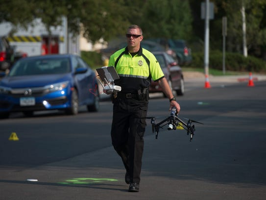 A member of the Fort Collins Police Crash Team prepares