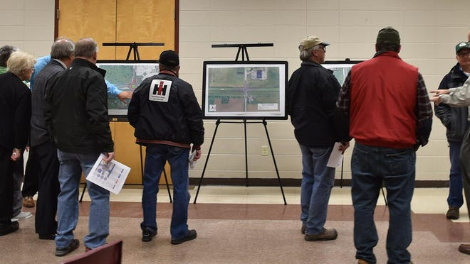 Wisconsin Department of Transportation regional project development manager Alan Rommel of Green Bay, right, answers questions about roundabouts.