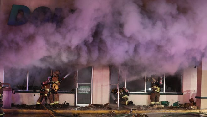 Firefighters work to extinguish a blaze that struck the Dollar Tree store in Beaver Brook Plaza, reported about 7:20 pm Friday.