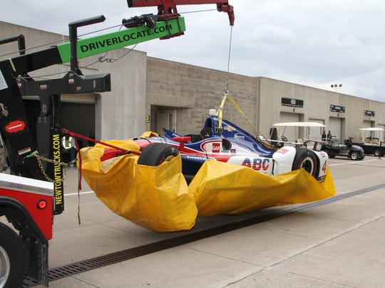 The car of AJ Foyt Racing IndyCar driver Conor Daly (4) is taken back to the garage area after his crash in the Indy 500 at Indianapolis Motor Speedway, Sunday, May 28, 2017.