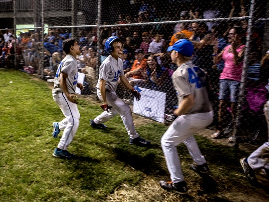 Players from LMH celebrate after scoring a series of