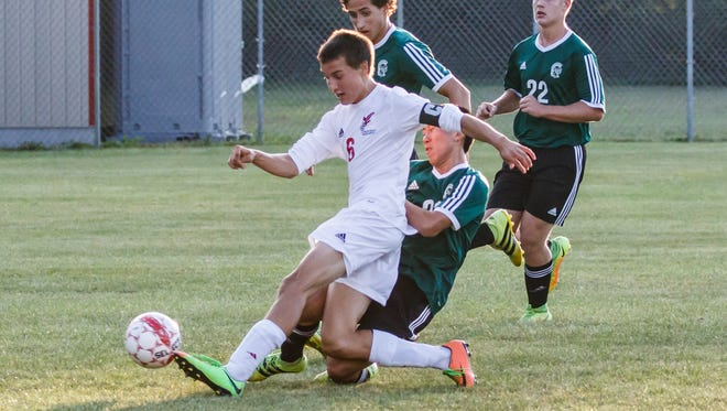 Arrowhead senior Luke Dubnicka (6) scores during the match at home against Madison Memorial on Thursday, Aug. 31.