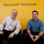 Mark Hirsch, owner of Creative Worx, left, and Dan Bloom, owner of Slope, pose in the offices of Microsoft Ventures in Seattle.