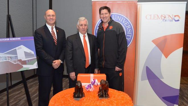 Clemson President James P. Clements, board trustee Joe Swann and men's basketball coach Brad Brownell