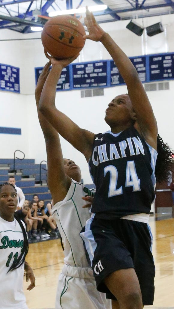 Chapin guard Madeline Jones puts up a shot against Dorsey guard Kierra Haynes during the opening round game of the 2016 McDonalds Classic basketball Tournament at Chapin High School Thursday afternoon. The Huskies dominated Dorsey with a tough and stingy defense giving them the win 75-21.