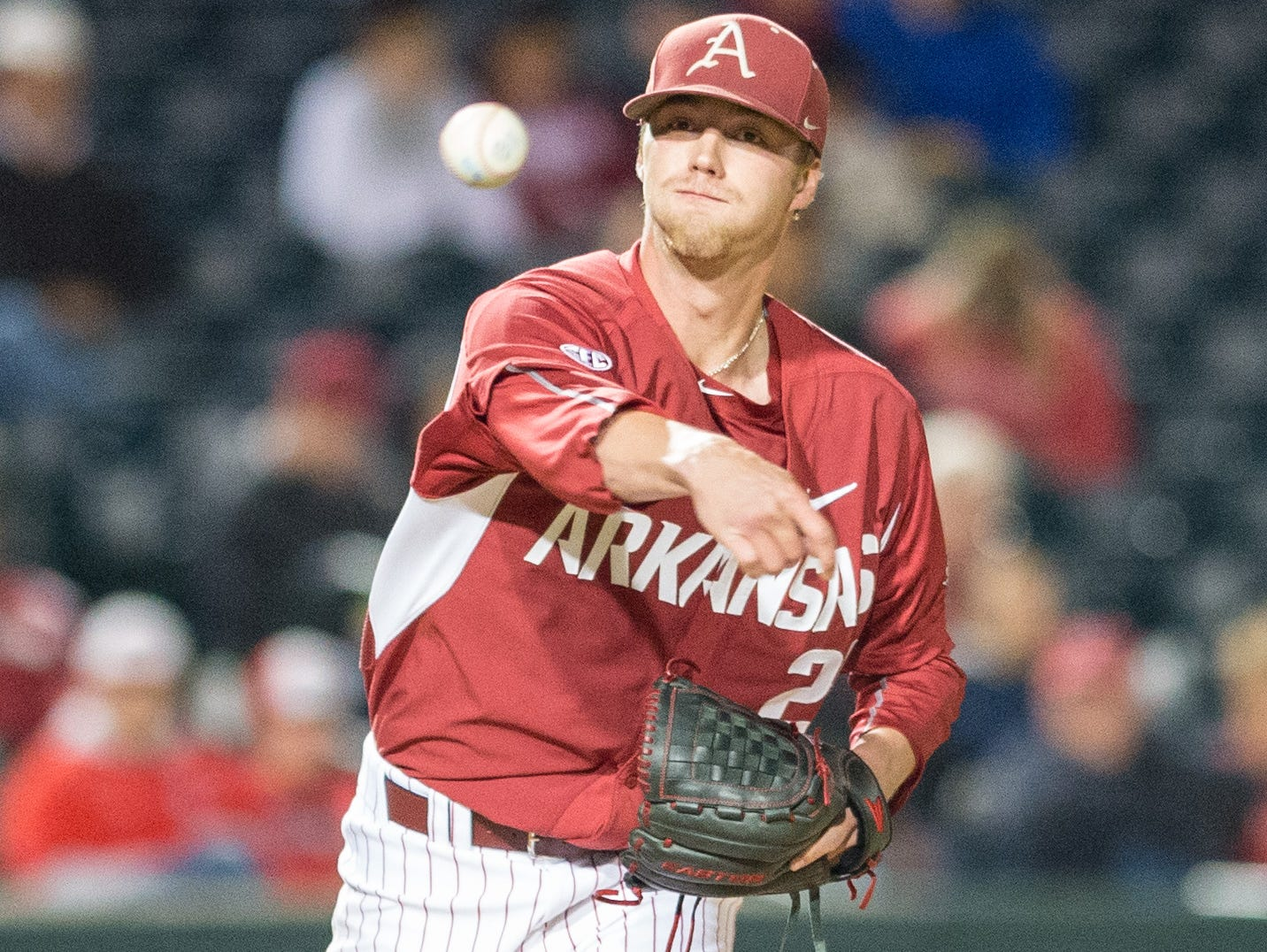 Arkansas pitcher Trey Killian throws to first on a pickoff attempt during a recent game at Baum Stadium. Killian will start Friday for the Razorbacks, who face Tennessee this weekend in their final home regular-season series.