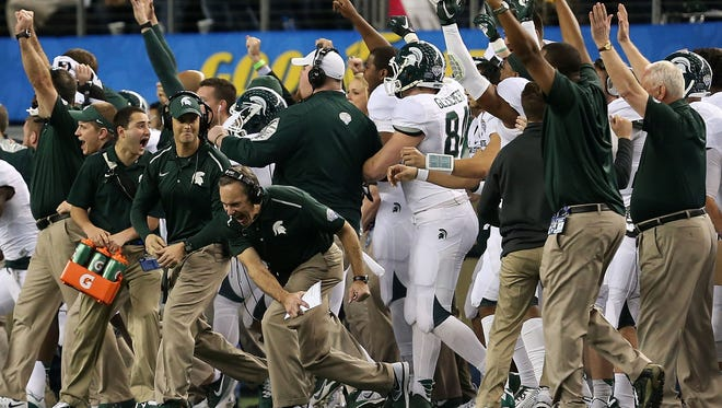 Michigan State coach Mark Dantonio celebrates his teams dramatic rally to beat Baylor in the Cotton Bowl on Jan. 1, 2015.