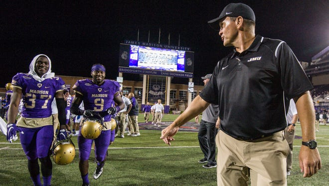 Franklin native Mike Houston made his debut as James Madison's football coach on Saturday and it was a record-setting affair for the Dukes.