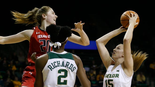 Texas Tech's forward Brittany Brewer (20) tries to keep Baylor's Lauren Cox (15) from shooting the ball during the second half of an NCAA college basketball game Sunday, Dec. 31, 2017, in Waco.