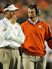 Clemson defensive coordinator Kevin Steele, left, and head coach Dabo Swinney during the 1st quarter of the Discover Orange Bowl Wednesday, January 4, 2012. BART BOATWRIGHT/Staff