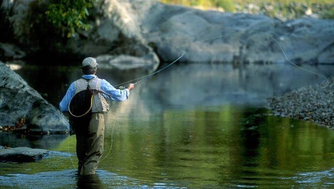 An angler casts his line in a Vermont stream in this undated photo. Fishing without a permit is allowed throughout the state on Saturday, June 11 as part of the annual Vermont Days celebration.