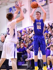 Clyde's Derick Harrah launches a jumper against Fremont Ross. Harrah had 22 points Saturday in a win over Bellevue.