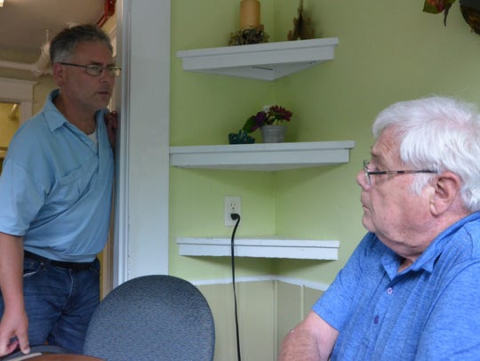 Richie Hess (left) talks to his father, Dave Hess,
