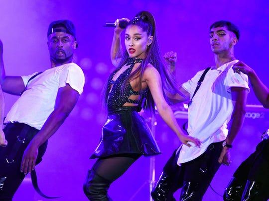 In this June 2, 2018 file photo, Ariana Grande, center,