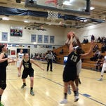 Wilson's Lia Goresh challenges a shot in a game against Grant.