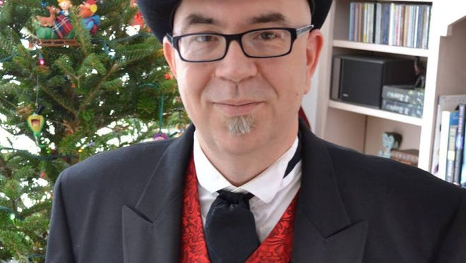 """Actor Jamieson Ridenhour brings a Victorian tone to the reading of Dicken's classic """"A Christmas Carol."""""""
