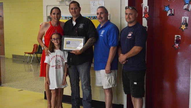 Representatives of the Clarkstown, Haverstraw, and New City Policemen's Benevolent Associations pose for a photo with Jen Labier and a student before the North Rockland Sports Day Thank You Breakfast on June 23, 2016.
