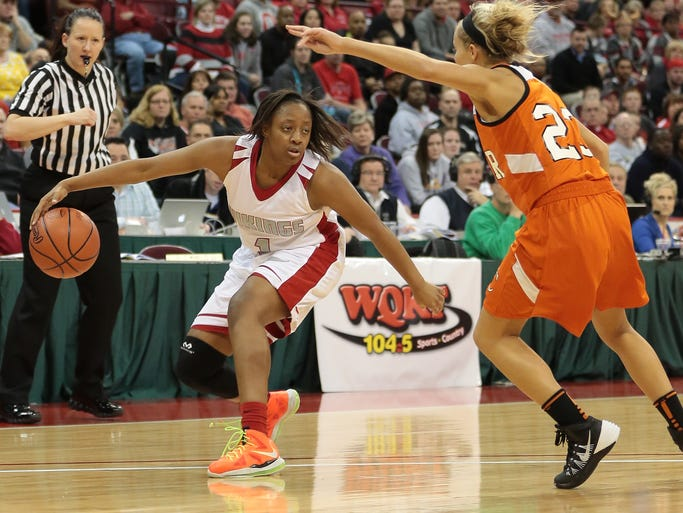 Princeton's Kelsey Mitchell drives to the basket.