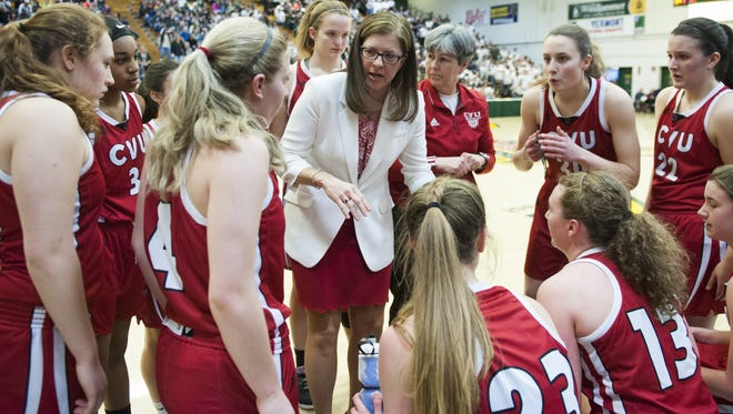 CVU head coach Ute Otley talks to the team during a time out during the division I girls basketball championship between the Champlain Valley Union Redhawks and the St. Johnsbury Hilltoppers at Patrick Gym on Saturday afternoon March 18, 2017 in Burlington.