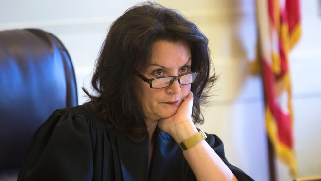 Hamilton County Common Pleas Judge Leslie Ghiz listens to Jack Greiner, attorney with Graydon Head, representing the Cincinnati Enquirer and several other outlets, during a hearing to determine media access during the second Ray Tensing trial. Tensing is charged with murder in the July 19, 2015 shooting of Sam DuBose. Tensing was a University of Cincinnati police officer at the time. The first trial ended in a hung jury.